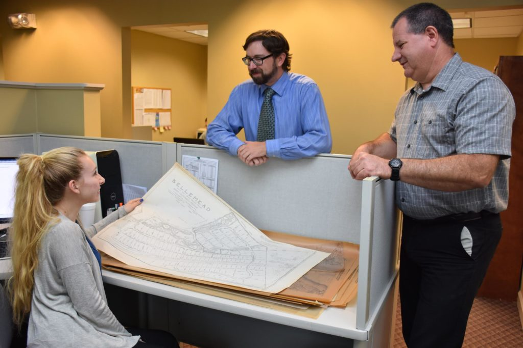 Courtney Sweet, drafting technician hired through NextGen, Andy Arnold, Design Operations Director and Bob Beck, CADD Manager